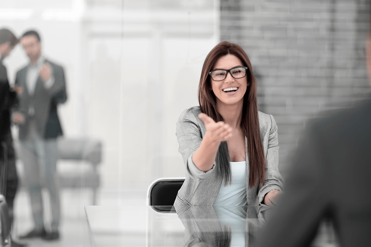 business woman with glasses shaking hand